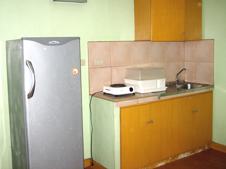 Studio kitchenette provides a small cooking area.